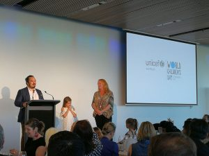 Adam Liaw at the podium, conversing to the participants